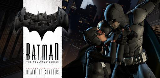 Batman holding cat woman from the wrist