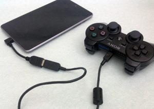Gaming controller connected with Android device using USB OTG.
